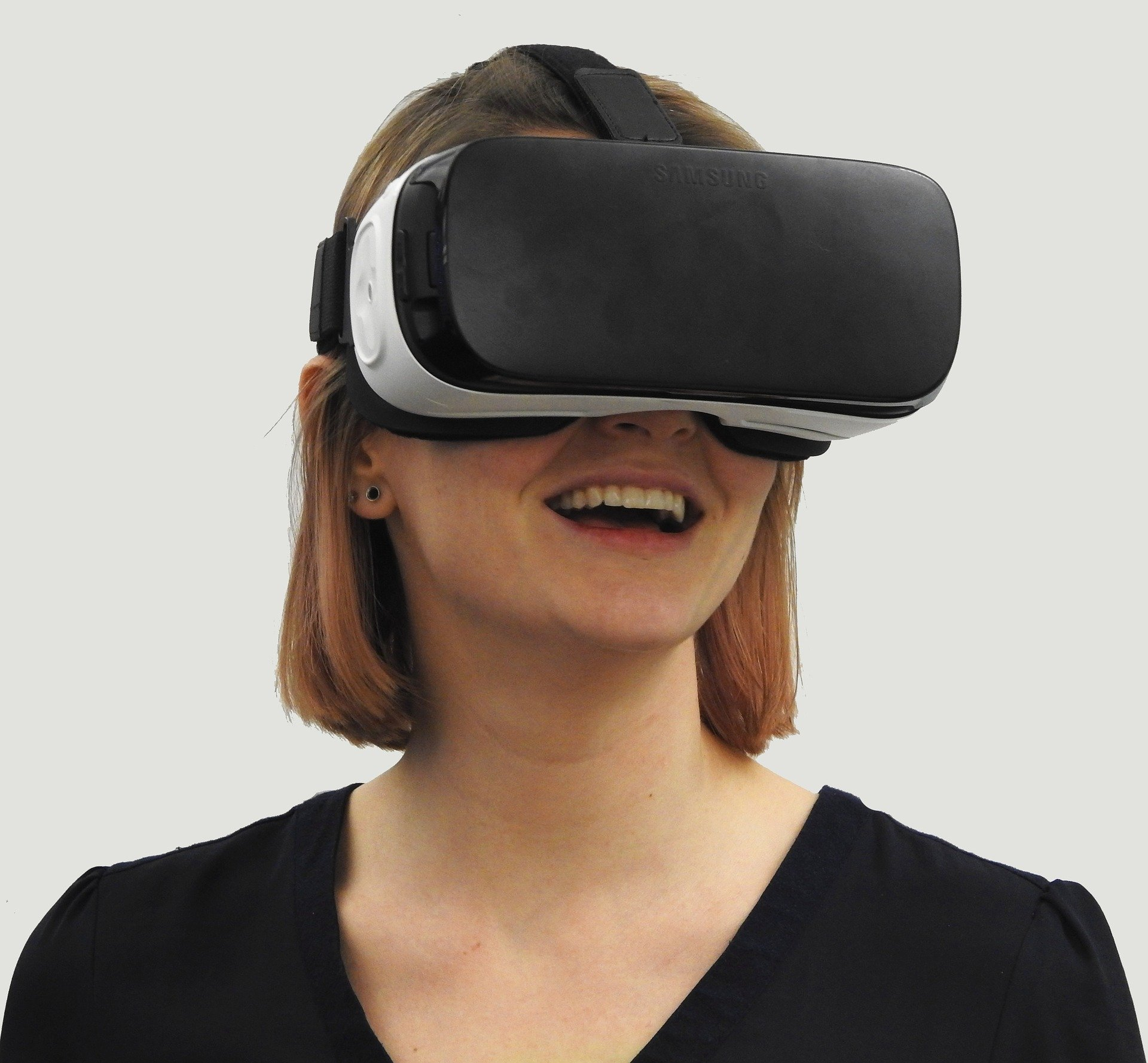woman smiling wearing vr headset