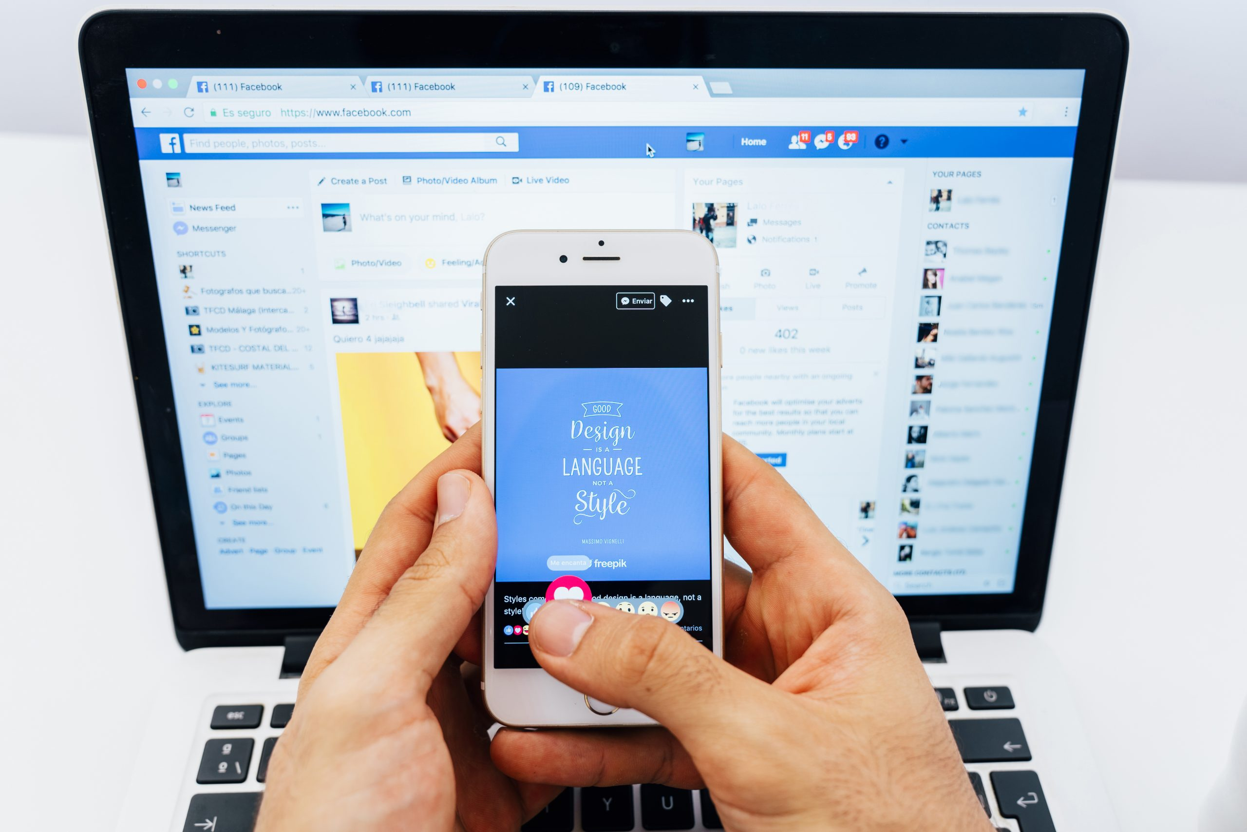 man holding smartphone with facebook screen showing
